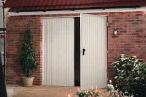 Steel side hinge garage door