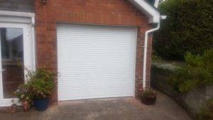white roller door on house